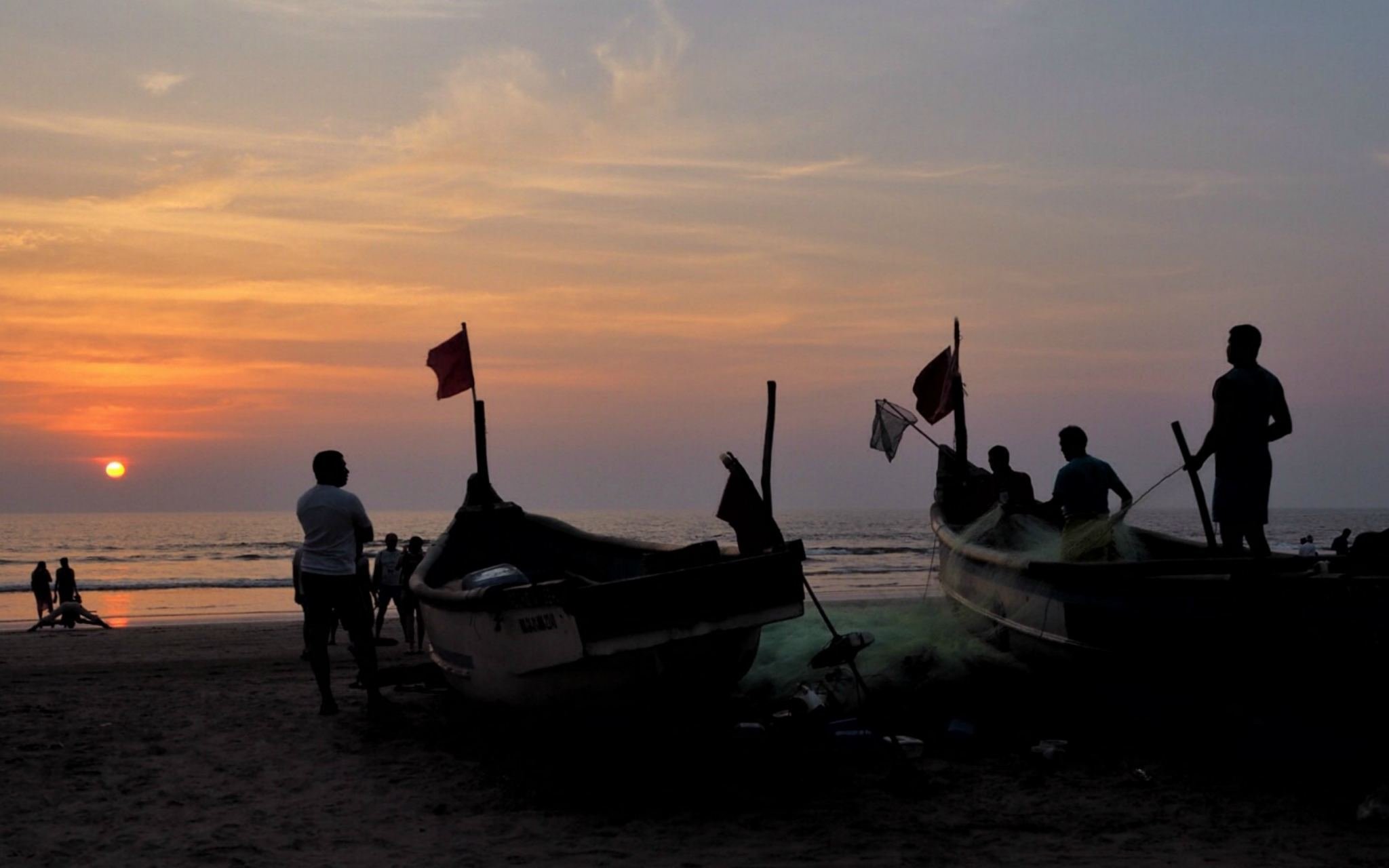 Fishing boats at sunset on Arambol Beach, North Goa