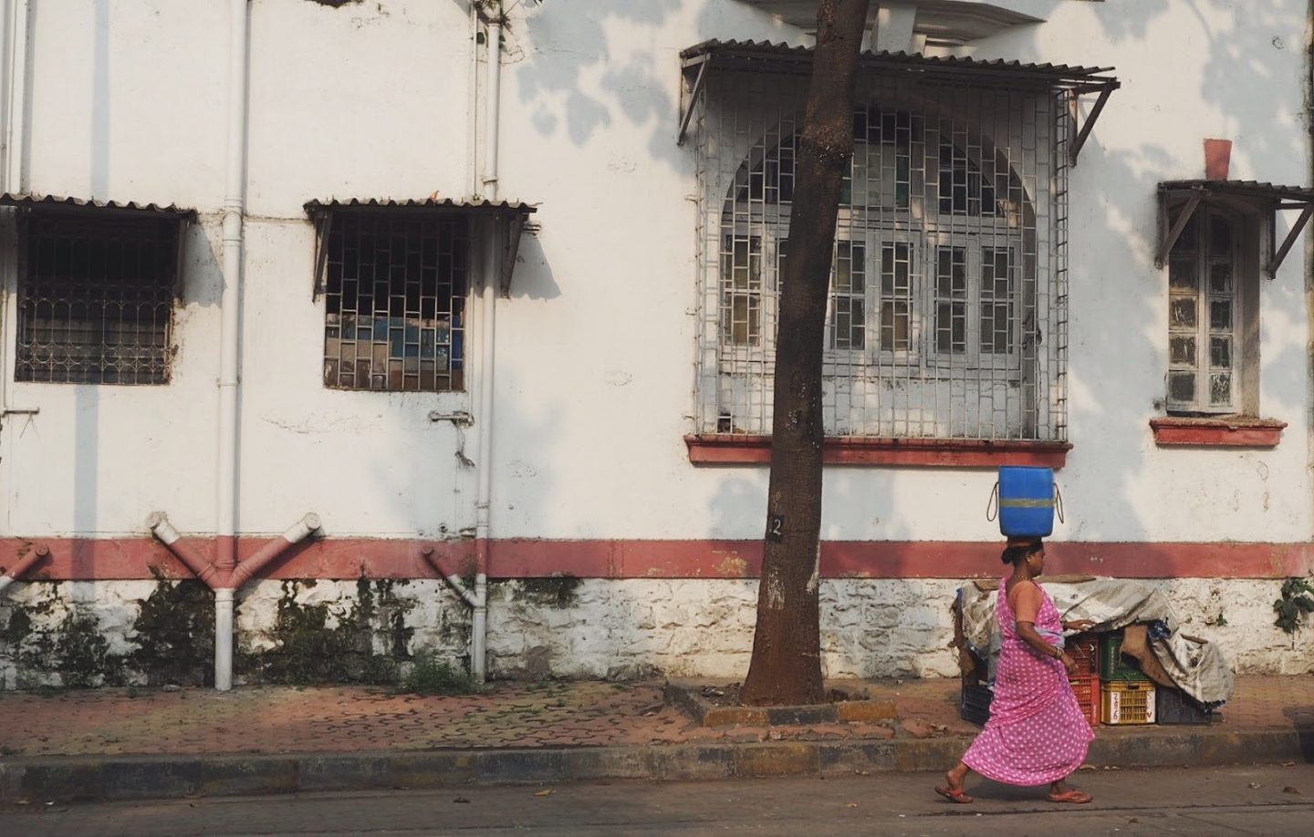 Ladies carrying buckets on their heads in Mumbai