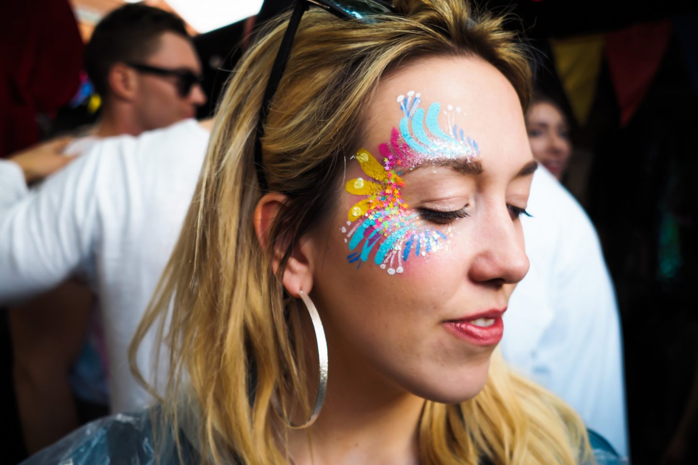 Pretty festival face paint with glitter by The Fashpack