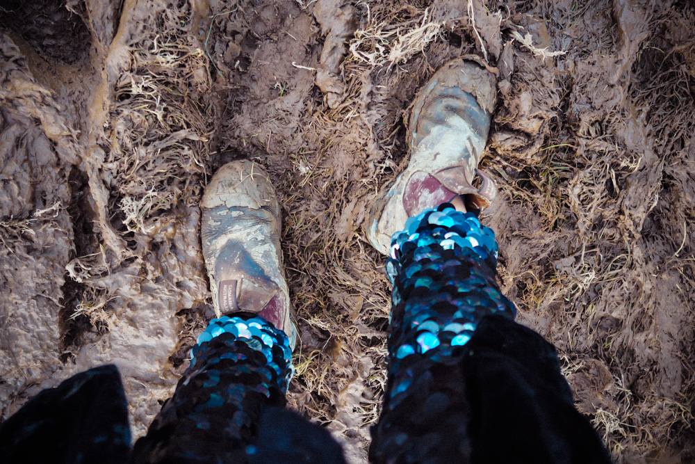 Blundstones and Rosa Bloom sequin leggings in the festival mud