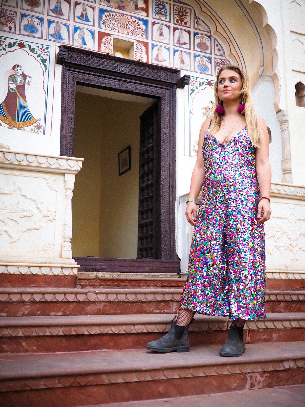 Blundstones and sequin jumpsuit, pom pom earrings, festival fashion at Magnetic Fields festival
