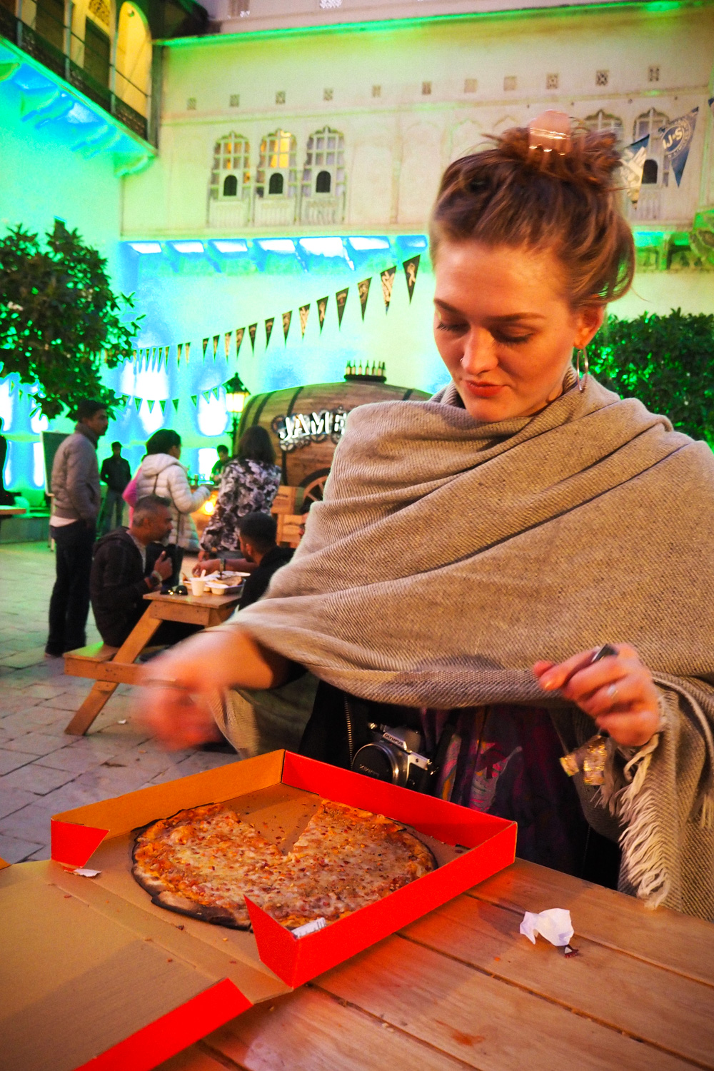 Eating pizza at Magnetic Fields Festival in Alsisar Palace